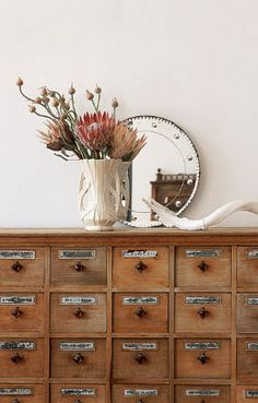 A dresser full of tiny drawers is incredibly charming. I don't care what we put in them, but it is a must-have. Buttons? Sure. Change? Of course. Fairly dust? Without a doubt.