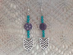 Unique turquoise, silver, and purple dangle earrings by Momsawrapstar on Etsy https://www.etsy.com/listing/231579107/unique-turquoise-silver-and-purple