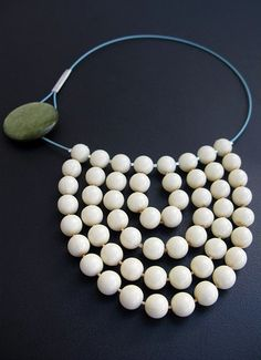 Necklace made from an old beaded necklace, stainless steel, enamel, button and sterling silver.LIANA KABEL