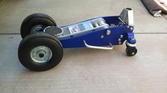 """Off Road Floor Jack by am4X4 -- Homemade offroad floor jack adapted from a standard model via the addition of 6"""" wheels to the front and replacement of the swiveling rear wheels with taller surplus units. To accommodate the larger wheels, a new axle was fabricated from 5/8"""" solid rod stock. http://www.homemadetools.net/homemade-off-road-floor-jack"""