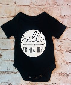 Hello, I'm New Here! Short sleeve black onesie. 100% Cotton. Available in sizes 3-6m, 6-9m, 9-12m. Runs true to size.