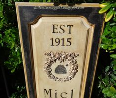 Old cabinet doors repurposed into signs from:  LittleMissMaggie: French Bee Farm