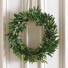 "Enjoy classic Mediterranean style for the holidays and all year round with our 22"" Olive Leaf Wreath. Meticulously hand crafted to look just like the real thing, this lush faux wreath is handmade with soft fabric green leaves you can fluff for a natural look. This fake greenery olive branch wreath gives an air of freshness you can enjoy year round. #OliveGreenery #IndoorWreath #Wreath #DoorDecor"