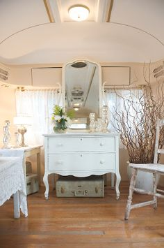 Ashley, this is a trailer!!!!  Shabby chic airstream.  We can go on the road with this for sure!