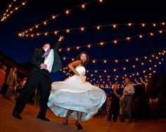 Bride and Groom dance the night away under the stars in the Courtyard at Spruce Mountain Guest Ranch in Larkspur, Colorado.
