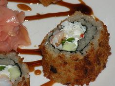 Sea of Fire Roll picture    Here is the last sushi dish I made for an anniversay cooking lesson dinner. It's a maki roll made with REAL crab (not that fake surimi crab you find at most sushi restaurants), cream cheese, fresh jalapeno, cucumber and green onion, rolled into crispy seaweed and seasoned sushi rice, then covered in panko bread crumbs and pan fried until crispy.    Cooking parties with www.friendthatcooks.com