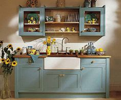 The egg shell blue is nice, as is the rustic look. But I adore the Belfast sink.