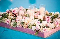 floating flowers and candles in the pool
