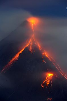 A forked tongue of lava scorches a side of the Philippines' Mayon Volcano on December 28, 2009. Mayon Volcano's recent eruptions may come as small surprise to area residents, many of whom likely remember the volcano's last eruption.