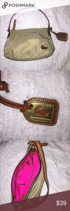 Dooney & Bourke 😍 D&B classic vintage 1975 bag. Used once if that. Great condition. Easy to keep clean nylon material and leather trim. Khaki color goes with all outfits! Dooney & Bourke Bags