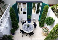 Great use of shutters and luv the mirrored doors to extend the space--traditional landscape by The Labyrinth Garden