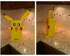 Pikachu Valentine box.  Shoe box wrapped in yellow paper, craft foam for ears, arms, feet, eyes,& tail, felt for cheeks, and marker for the mouth.