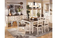 """The Whitesburg Dining Room Extension Table from Ashley Furniture HomeStore (AFHS.com). With the warm two-tone look of the cottage white and burnished brown finishes beautifully accenting the stylish cottage design, the """"Whitesburg"""" dining collection creates an inviting cottage retreat within the décor of any dining room."""