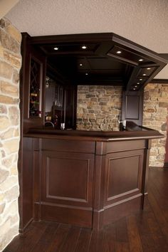 Side View Of A Basement Bar with Granite Countertops.