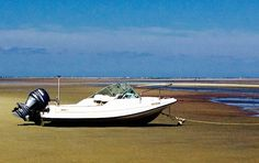 A Boston Whaler on the flats at Breakwater Beach, from Storm Watch