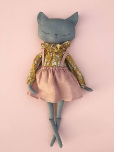 Hi, This is Majsan. She is hand made with lots of love and in 100% super soft blue/gray linnen fabric. She is 46 cm/18,5 inch tall with flappy arms and legs. Her blouse is made of Liberty of London fabric in 100% cotton with removable collar. And to match here blouse she has got a