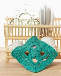 This 3-D celtic knot begins as 4 separate rings but are joined together in a beautiful dishcloth or hot pad.