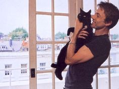 brett anderson and his cat. In London. so cute!!!