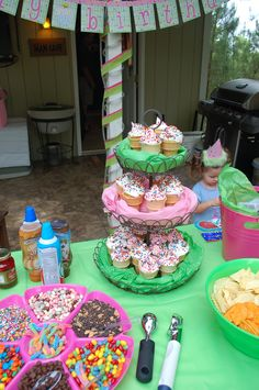 An Ice cream social!  A dream party for my then 3yr old daughter.  ice cream cone cupcakes, an ice cream pinata, ice cream dishes and spoons as favors filled with ice cream and the kids decorated sundaes from a huge selection of candies and syrups...and the best part, it all took place outside! no mess!