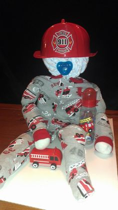 Fireman Baby diaper cake all baby useable items!!! Great for gift or baby shower centerpiece!!! Momma T's Creative Delights