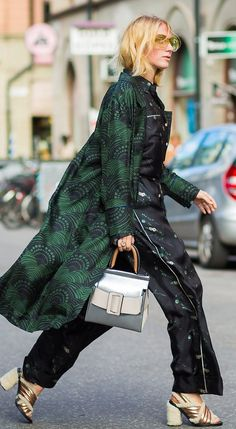 A green printed coat over a silk pajama-style outfit. See more street style from Stockholm Fashion Week. Photographed by Photographed by Acielle / Style du Monde.