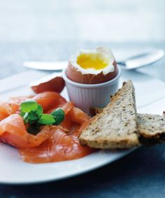 Breakfast in bed the Scandinavian Way with smoked salmon, toasted rye bread and a soft-boiled egg, taken from Trine Hahnemann's 'The Nordic Diet'.    Photography ©Lars Ranek