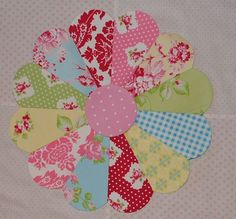 Lovely Dresden Plate (?) Quilt block.    The fabrics are so fresh and vibrant, love this.