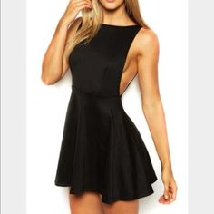 """American Apparel Skater Dress A-line dress featuring a deep pointed scoop back, a fitted waistline and a full, shirred skirt. • 60% Rayon 35% Nylon 5% Elastane construction • Medium is approximately 29 1/2"""" (74.93cm) in total length • Form-fitting American Apparel Dresses"""