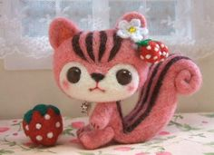 What a cute little kawaii style squirrel. I really like that he is pink and has a strawberry theme. Those stripes are just flawless and his face is just too cute.