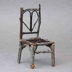 Furniture Made of Tree Limbs | rustic dolls house chair made from twigs with a heart shaped back.