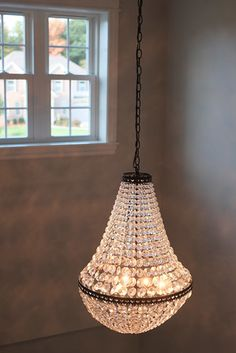 A classic chandelier lights up this space. Cobblestone lighting, PH87. Follow the link for the full home photo gallery.