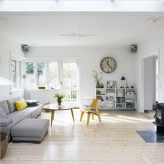 neutral living space with gorgeous light and i love the retro details in the furniture...