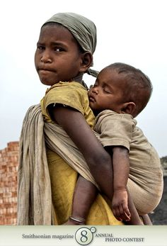 """Photo of the Day - February 29, 2012: """"A little girl taking care of her baby brother."""" Taken by Debasis Majumder (Kolkata, India). Photographed February 2010, West Bengal, India."""