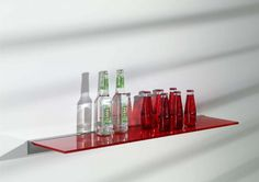 red glass shelving for bottles