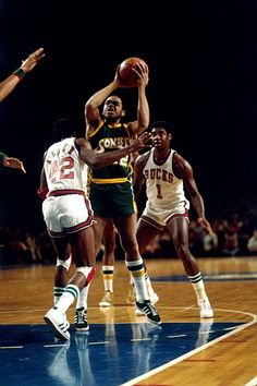 Walt Hazzard of the Seattle Supersonics goes up for a shot during a game against the Milwaukee Bucks in the 1970 season at the MECCA Arena
