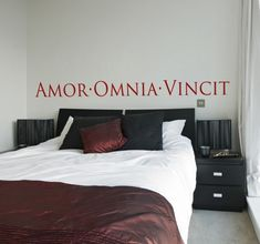 """Decorative #sticker with a #romantic Latin text; """"Amor Vincit Omnia"""", which translates to """"Love conquers all"""". #Decorate the walls of your #bedroom or your living room with a declaration of #love that will create a cultural and romantic feel. Especially ideal over the headboard of your bed. Available in a variety of sizes and more than fifty different colours. #tenstickers"""