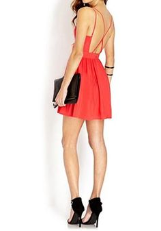 Feel sassy and beautiful in this little red dress. Its v-neckline an open back are detailing that can flatter your figure.