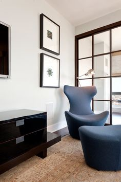 Stamford penthouse: B and B Italia fabric, chair and ottoman, Christian Liagre for Holly Hunt console, lamp Restoration Hardware, glass screens by Shoji Living