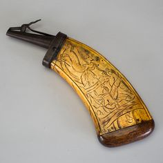 POWDER HORN, bone and wood, 18th century. Decorated with hunting scenes. Length 29 cm.