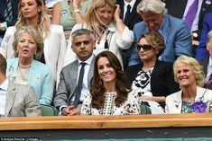 Kate is wearing a printed ivory dress by Alexander McQueen for the final, which sees Andy Murray take on Canadian Milos Raonic
