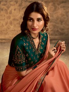Product Features : Color: Orange Fabric: Art Silk Saree Length: Meters Saree Width: Inches Type Of Work: Embroidered Blouse Length: Meters Blouse Color: Dark Green Disclaimer: Color and Texture may have slight variation due to photography Fancy Sarees Party Wear, Designer Party Wear Dresses, Indian Designer Outfits, Party Wear Sarees Online, Designer Wear, Silk Saree Blouse Designs, Fancy Blouse Designs, Bridal Blouse Designs, Lehenga Designs
