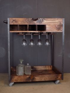 Reclaimed Industrial Bar Cart made of pine, steel and black pipe with casters in a Red Oak finish.