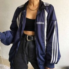 Black boob tube, black jeans with big belt and a dark blue addidas jacket