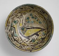 10th century  Samanid period, AH 204-395 / AD 819-1005  Creation Place: Nishapur, Iran  Buff-colored earthenware painted with black (manganese), yellow (lead-tin), and green (copper) under clear lead glaze  6.7 x 16.2 cm (2 5/8 x 6 3/8 in.)