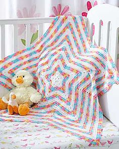 Beautiful striped star baby blanket radiates outward in Bernat Baby Coordinates. (Bernat.com) Also numbered 5389 in different colors.