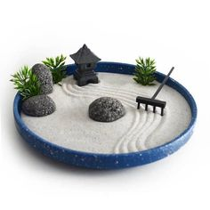 What a humidifying diffuser does is usage electronic frequencies to vibrate a little disc or platform which is submerged in some liquid. Diy Essential Oil Diffuser, Diffuser Diy, Miniature Zen Garden, Mini Zen Garden, Indoor Zen Garden, Desktop Zen Garden, Garden Terrarium, Garden Rake, Terrarium Bowls