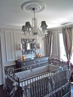 Glamorous gray baby nursery with chandelier love love love awesome for expecting parents who wait to the last min to find out sex!!!! Love the ease of transition to boy or girl!