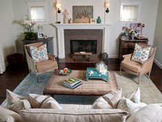 For this traditional living room, designer Darci Goodman uses lots of linen and turquoise to create a sand- and sea-inspired color palette ideal for guests and the homeowners alike. The room feels perfectly cozy and inviting thanks to a mix of flea market furnishings topped with seashells and heirloom accessories.
