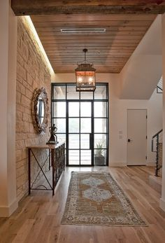 Contemporary foyer with metal door and transom.  Square pendant light