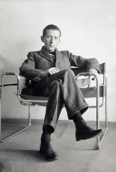 Hungarian-born modernist, architect and furniture designer, Marcel Breuer in one of his Wassily chairs